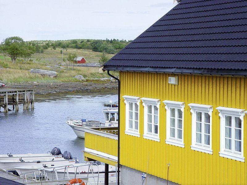Angelreisen Norwegen 42611 Løvøen Gård Ansicht mit Hafen