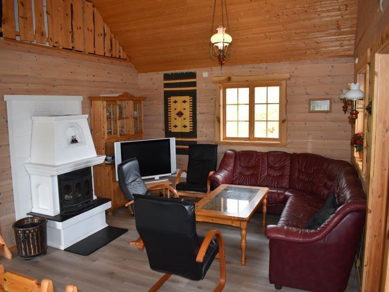 Angelreisen Norwegen 41872 Nesøya Brygge Wohnbereich mit Kamin